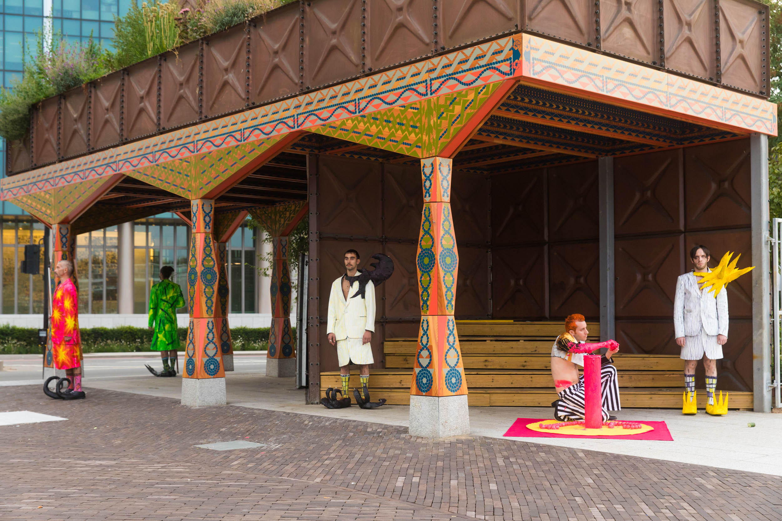 Five Knaves males masculinity in front of the US embassy under the Nine Elms pavilion wearing very colourful clothes and evident protrusions